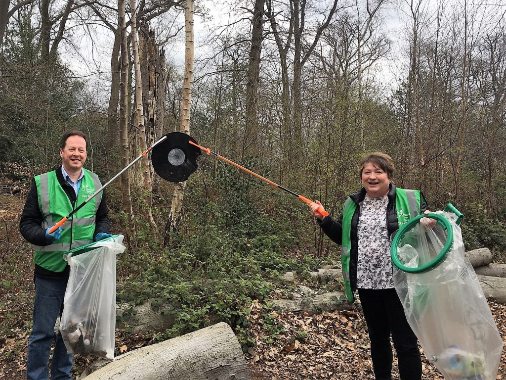Colin and Pauline holding up a broken record at a litter pick.